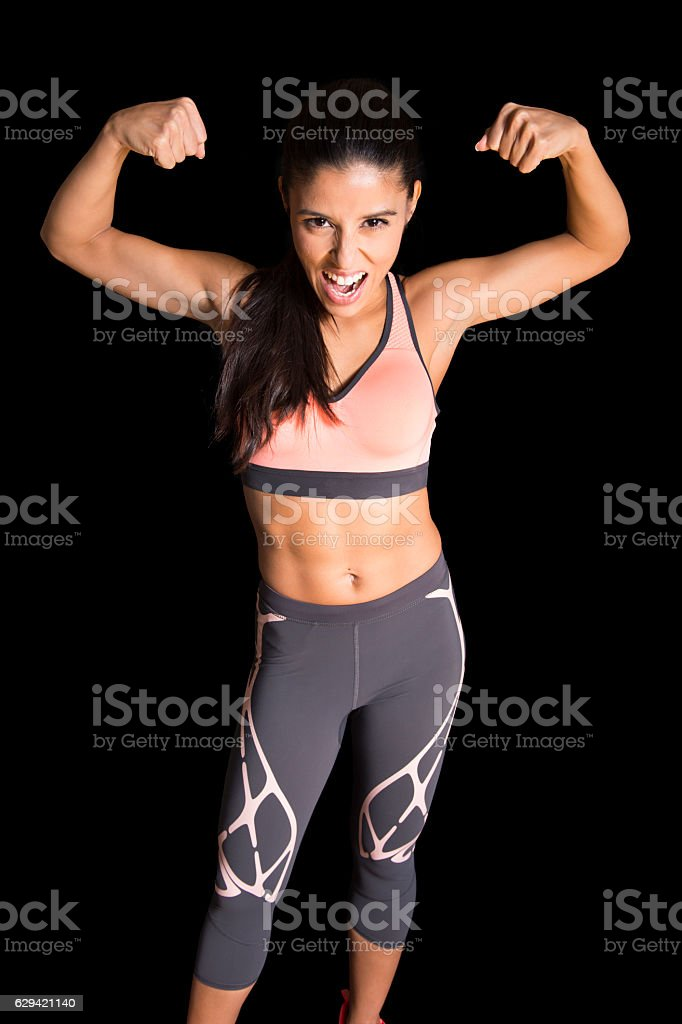 sexy latin fitness sport woman posing with fierce face expression stock photo