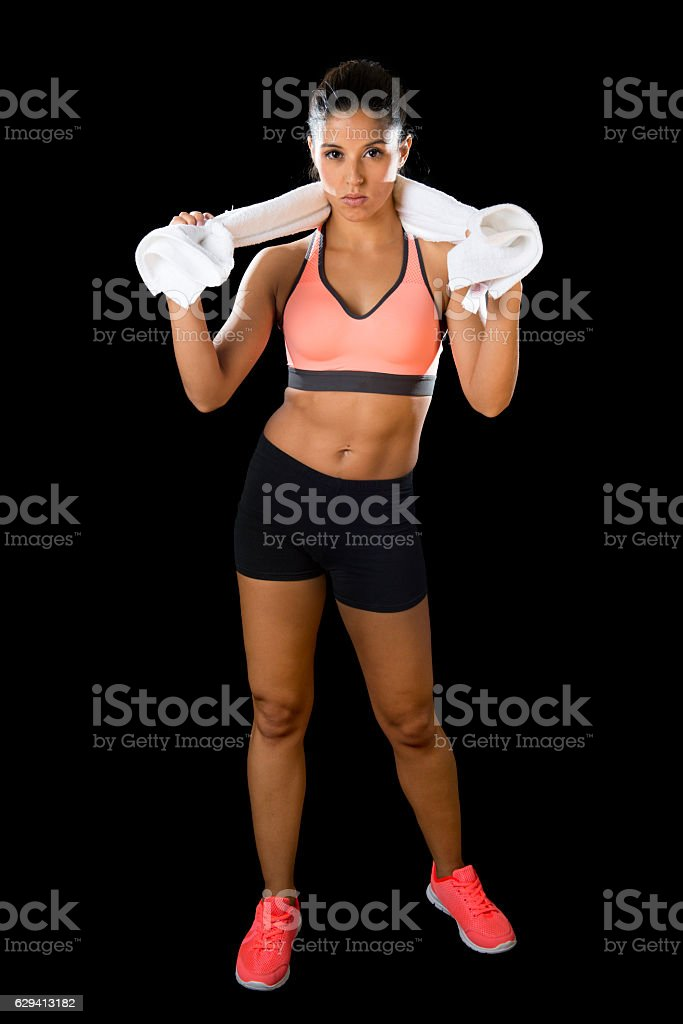 sexy latin sport woman posing with towel fierce face expression stock photo