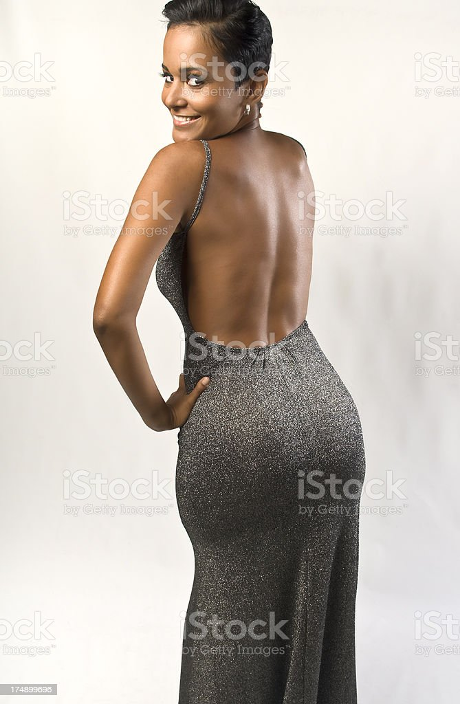 Sexy Latino Female Pose In Backless Gown stock photo