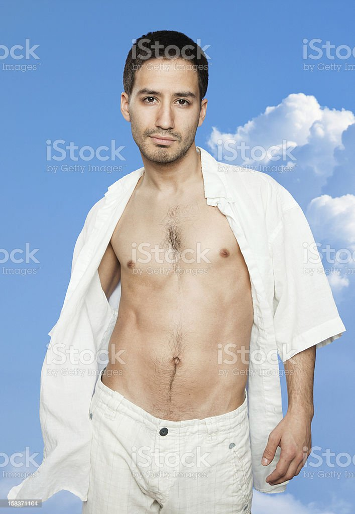 Sexy Latino Man In Front Of Blue Sky Royalty Free Stock Photo