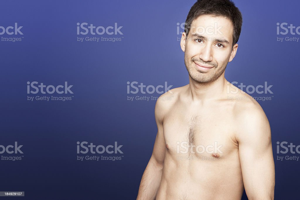 Sexy Latino Man On Blue Background Royalty Free Stock Photo