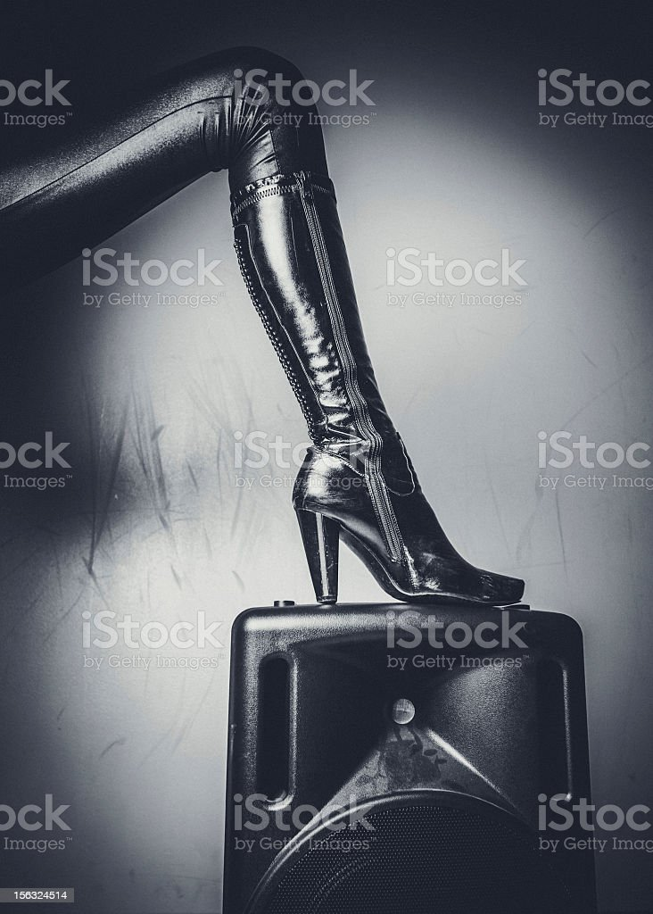 Sexy leather boot on speaker. stock photo