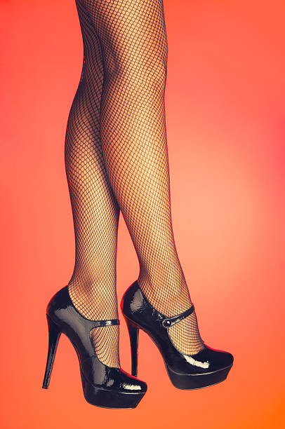 Sexy legs in fishnet stockings stock photo