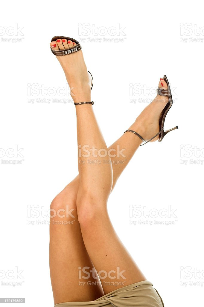 Sexy legs in high heels stock photo