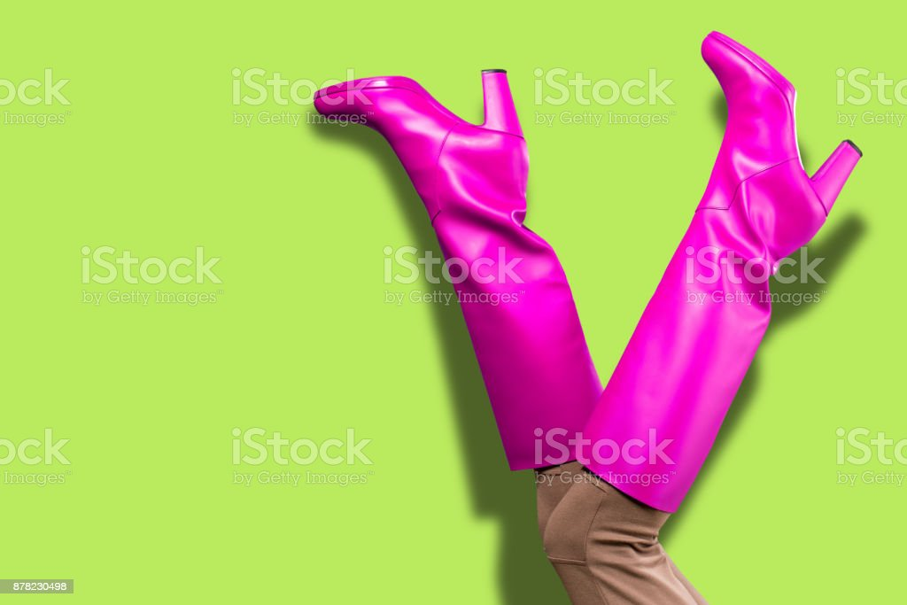 Sexy legs in pink high boots