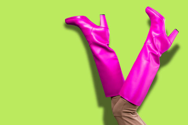 Sexy legs in pink high boots Sexy legs in pink high boots over neon green background boot stock pictures, royalty-free photos & images