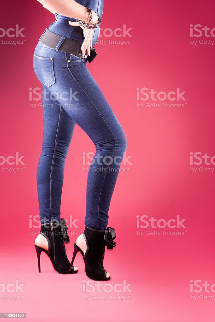 Sexy legs of beautiful woman, isolated on red royalty-free stock photo