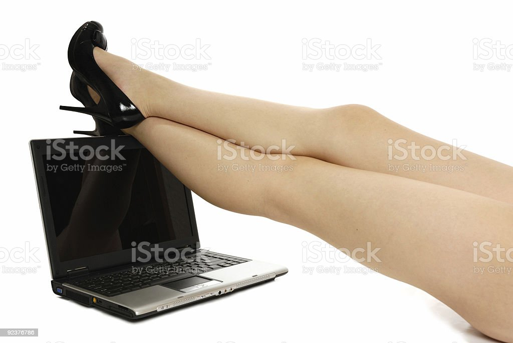 sexy legs over laptop isolated on white royalty-free stock photo