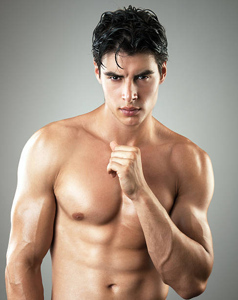 sexy male model sexy male model posing shirtless shirtless male models stock pictures, royalty-free photos & images