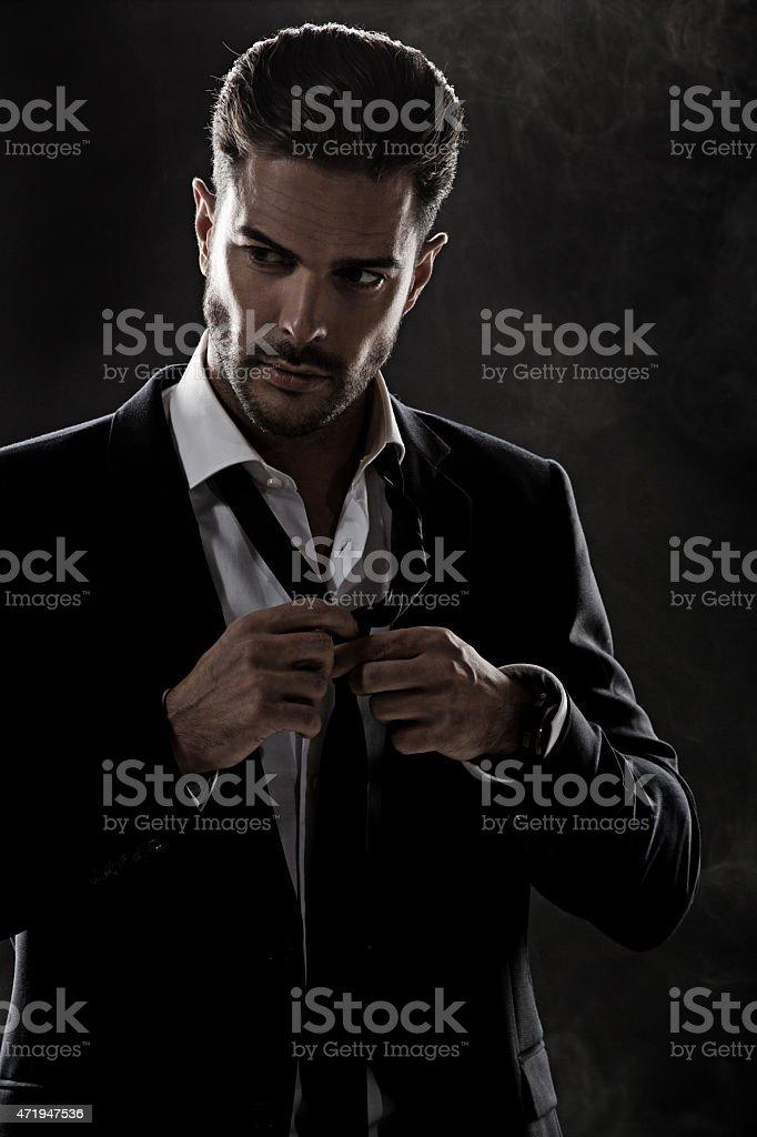 sexy man fixing his tie stock photo