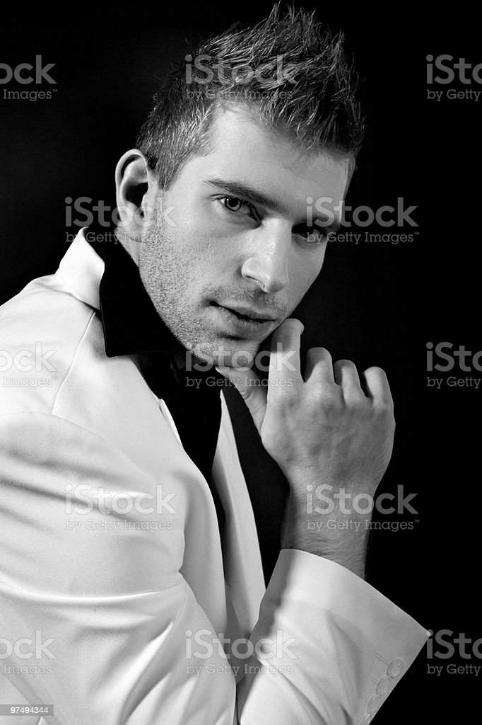 Sexy man in white suit royalty-free stock photo