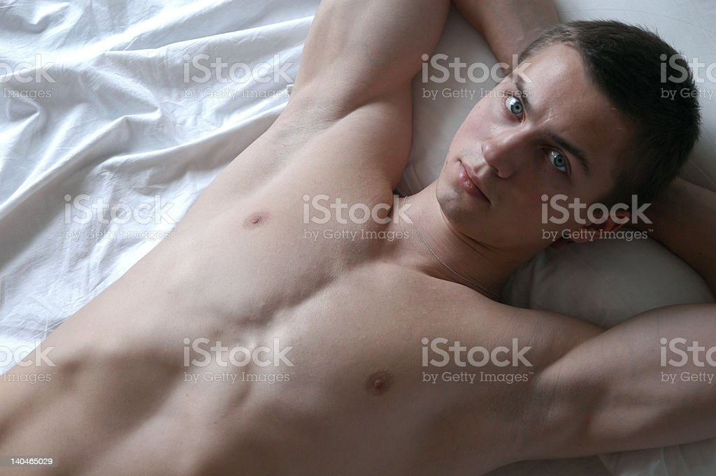 Sexy Man on the Bed royalty-free stock photo