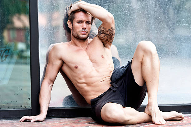 Sexy Man Sexy muscle young man sitting on the floor shirtless male models stock pictures, royalty-free photos & images