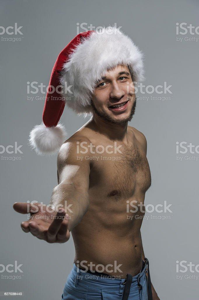Sexy men in santa hats