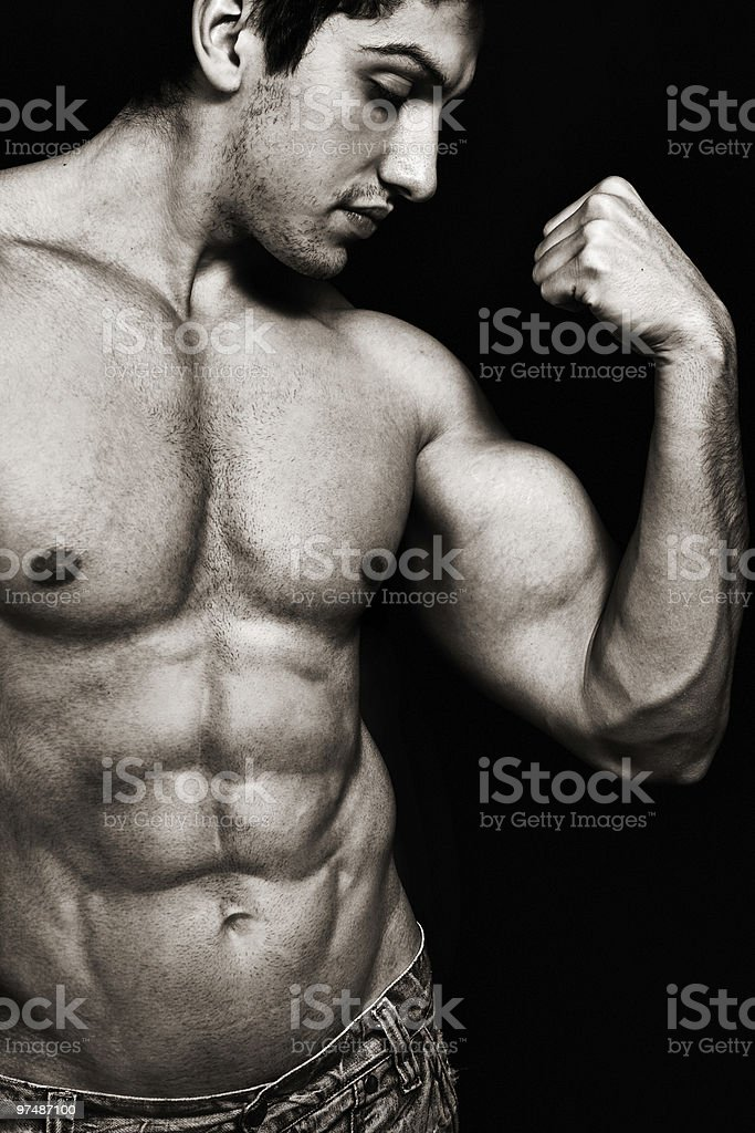 Sexy man with muscular biceps and abs royalty-free stock photo