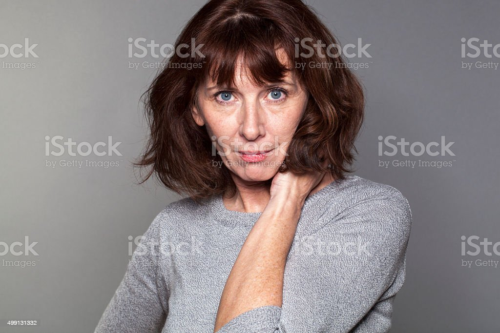 royalty free thinking woman with brunette hair pictures, images and