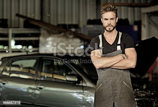 498879174 istock photo sexy mechanic posing at workshop 498882918