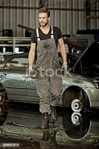 498879174 istock photo sexy mechanic walking at workshop 498882814