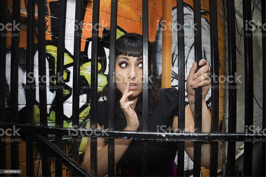 Sexy Model behind bars royalty-free stock photo