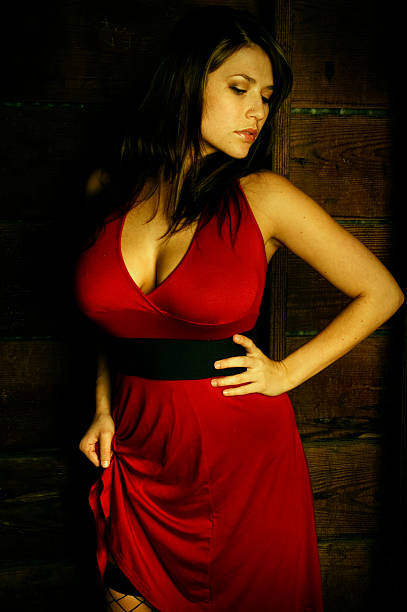 sexy model in red dress - curvy voluptuous women stock photos and pictures