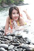 istock Sexy model on the black stones beach 148035427