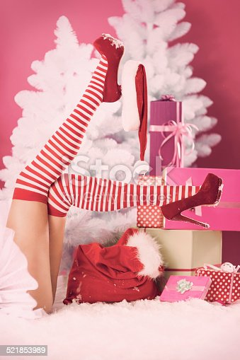 istock Sexy moments for female santa claus 521853989