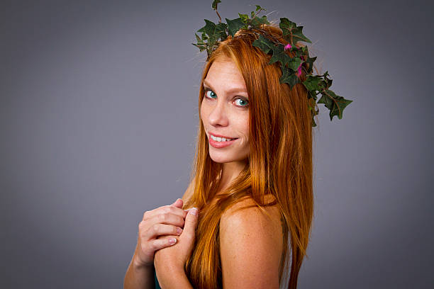 sexy mother nature - woman green eyes red hair stock photos and pictures