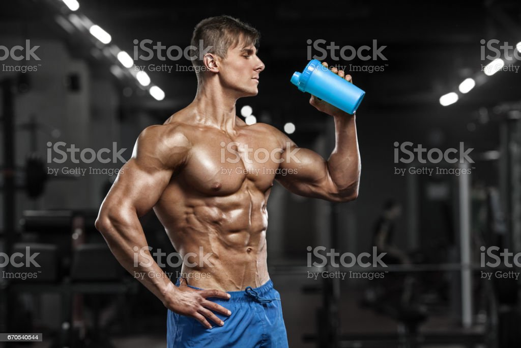 Sexy muscular man drinking water in gym shaped abdominal strong sexy muscular man drinking water in gym shaped abdominal strong male naked torso abs sciox Choice Image