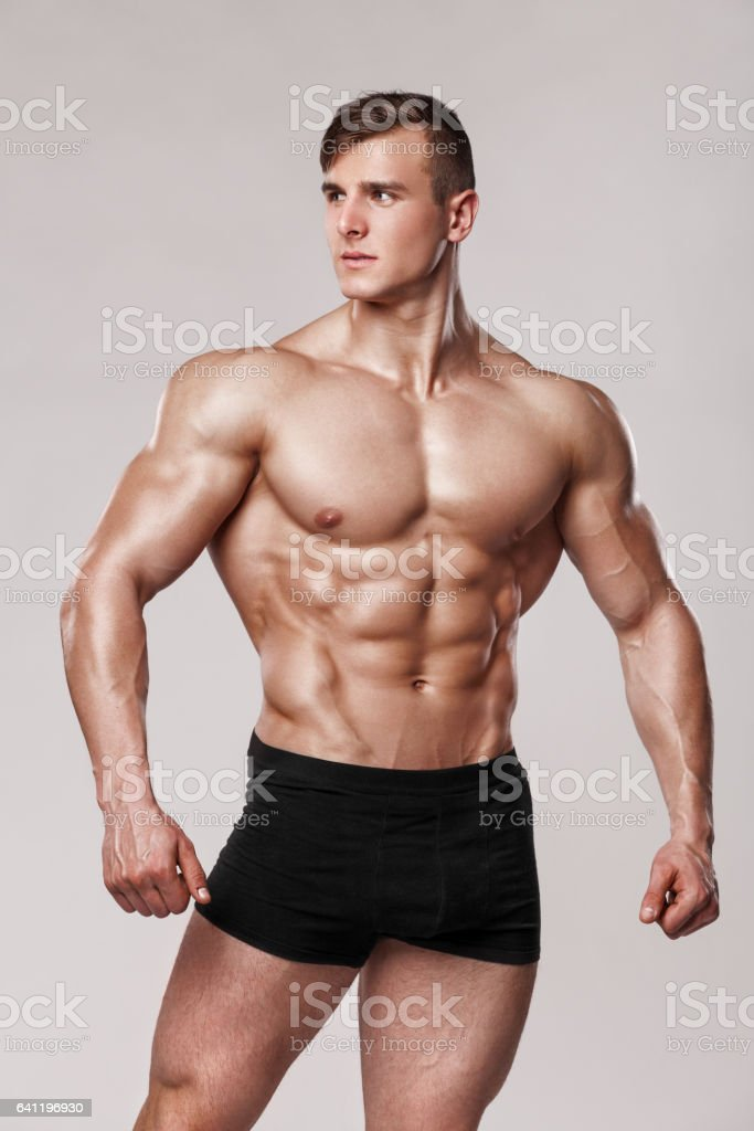 Sexy muscular man fitness model in underwear. male torso abs stock photo