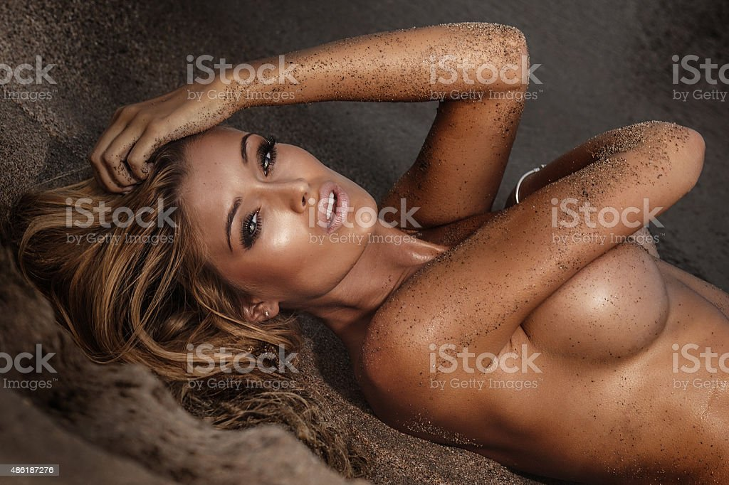 Sexy naked girl on the beach. stock photo