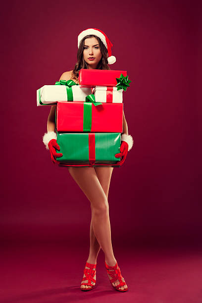 sexy naked santa with christmas present - naked santa claus stock pictures, royalty-free photos & images