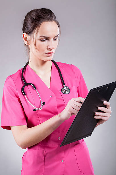 Sexy nurse in pink stock photo