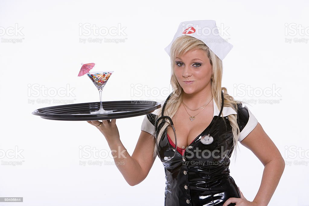 Sexy nurse serving pill cocktail royalty-free stock photo