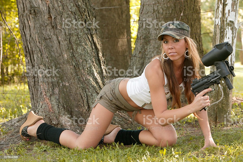 sexy paintball girl looking at the camera stock photo