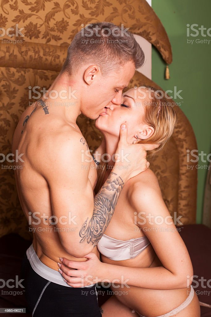 Sexy Passionate Couple Hugging On The Bed Stock Image