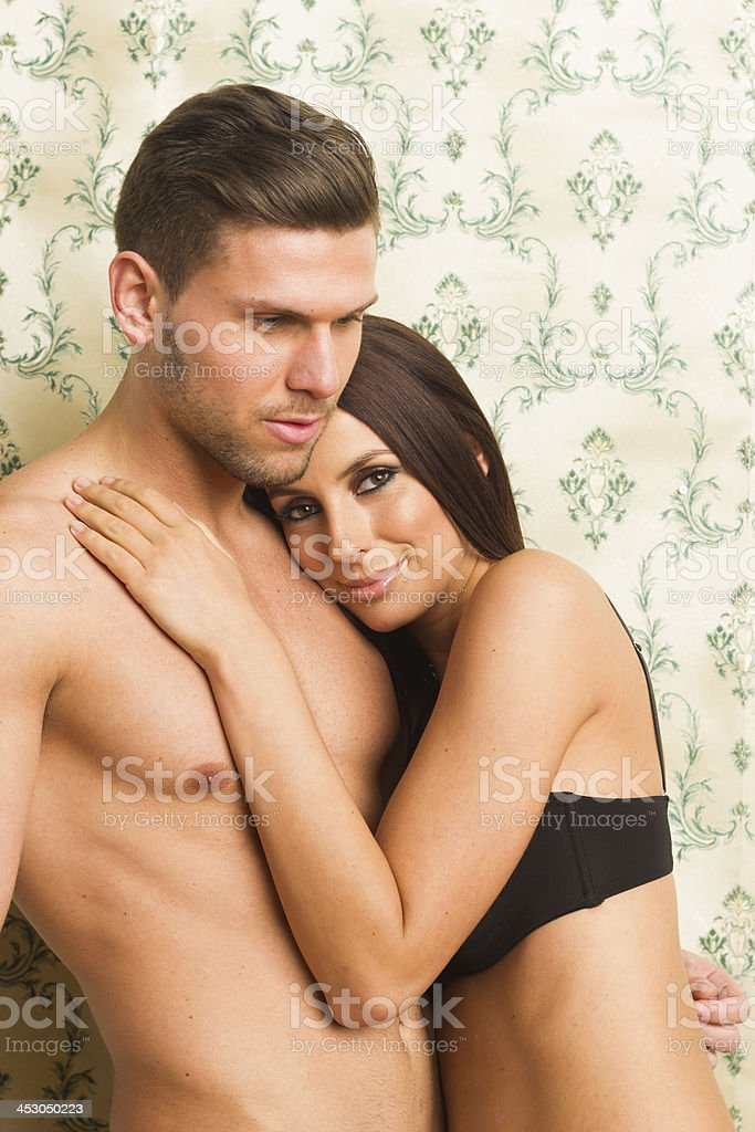 Sexy passionate heterosexual couple embracing royalty-free stock photo