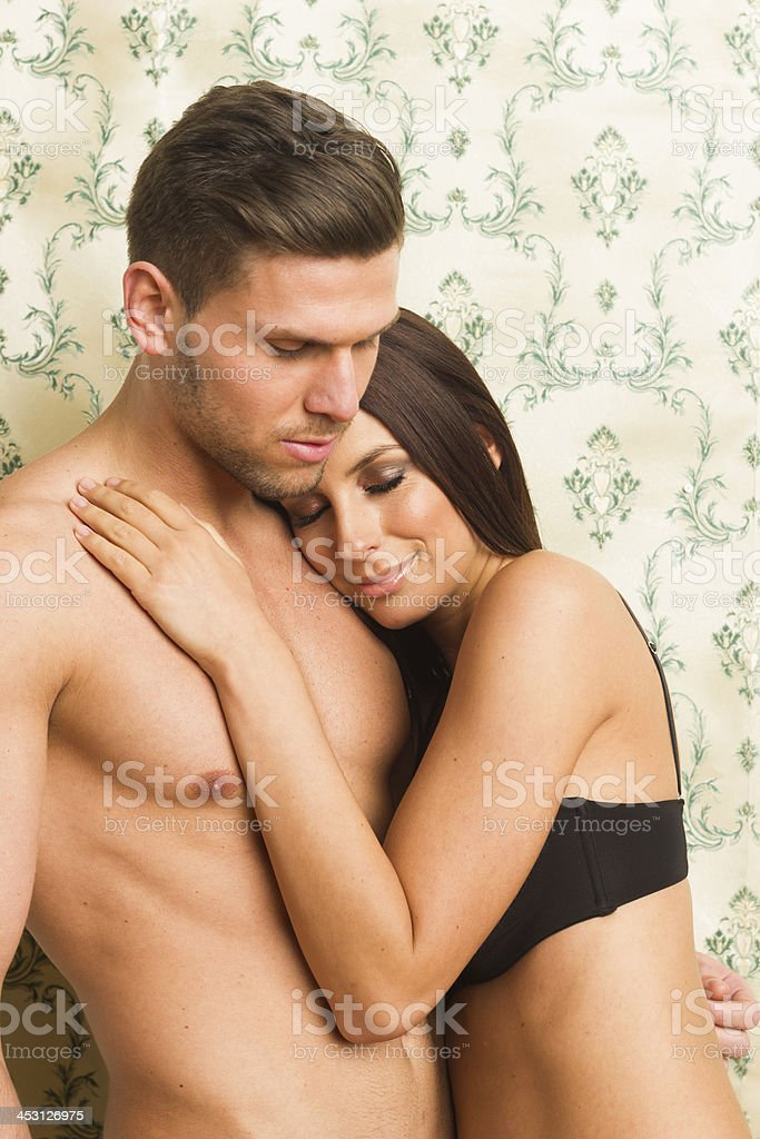 Sexy passionate heterosexual couple embracing royalty-free stock photo