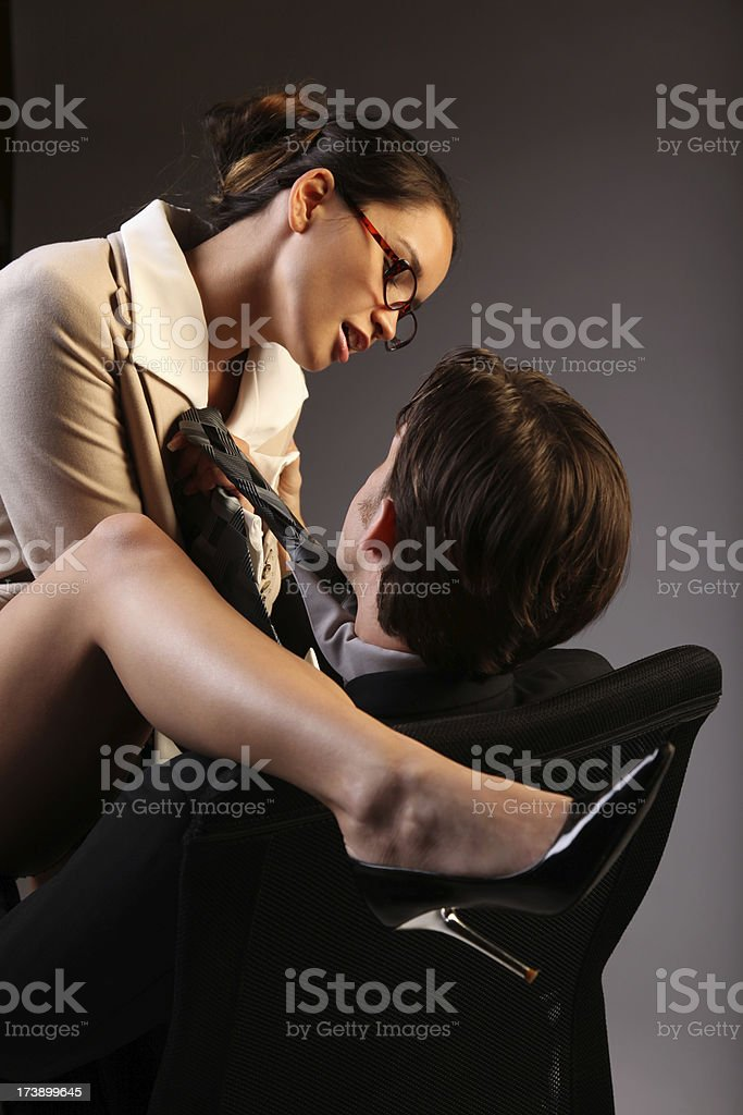 Sexy Passionate Lovers At The Office Stock Image