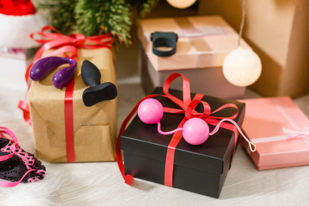 Sexy present for Christmas with christmas tree. Sexy present for Christmas with christmas tree. dildo stock pictures, royalty-free photos & images