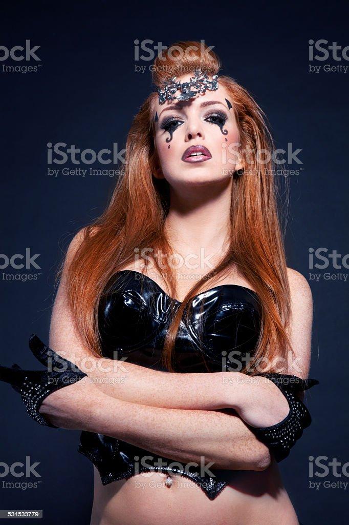 Sexy Redhead Black Corset Woman stock photo