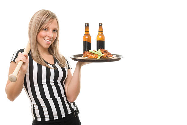 Sexy Referee Waitress Holding Bat stock photo