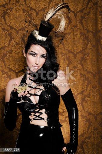 512061362istockphoto Sexy Retro Cabaret - Glamorous Vixen with Vintage Glass 158271776