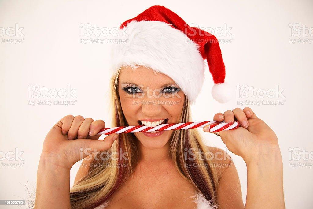 Sexy Santa biting candy cane stock photo