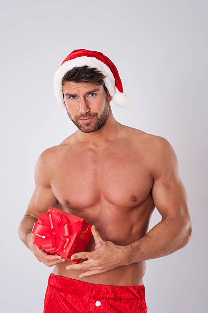 sexy santa claus has surprise for you - naked santa claus stock pictures, royalty-free photos & images