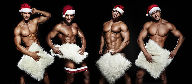 sexy santa claus posing. - naked santa claus stock pictures, royalty-free photos & images