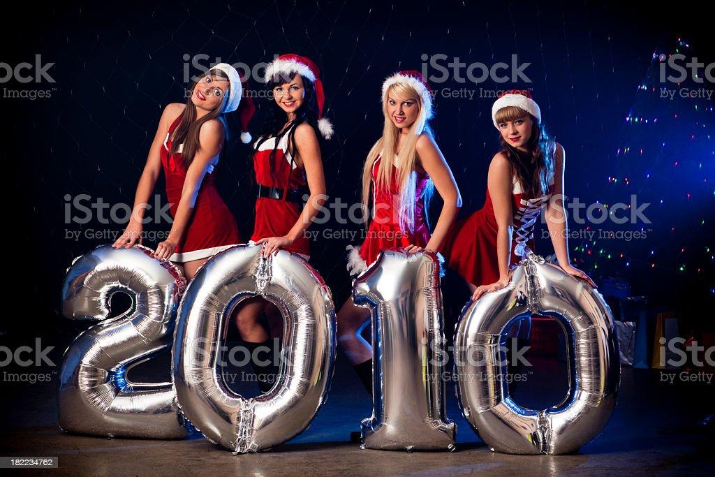 Sexy Santa Girl's holding 2010 silver balloon's stock photo