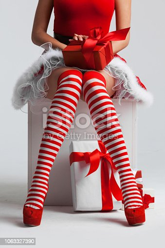 Sexy Santa woman legs and Christmas gifts