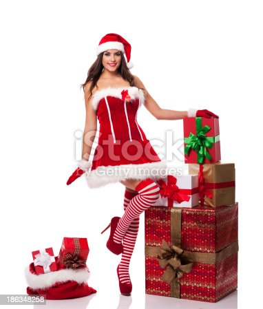 istock Sexy santa woman with christmas presents 186348258