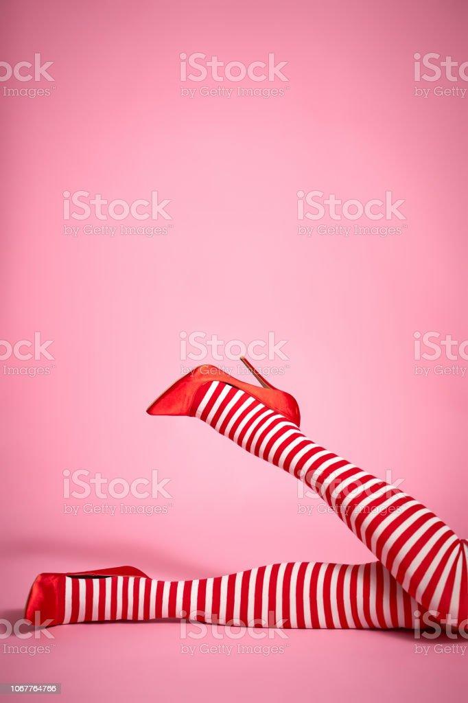sexy santa woman's legs on a pink background – zdjęcie