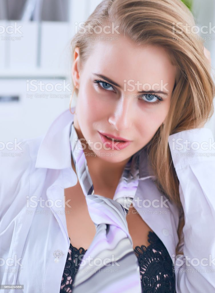 Sexy secretary in glasses undresses in office, flirt and desire. Office provocation royalty-free stock photo